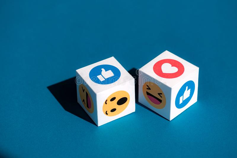 Facebook Emoticons Printed on a Cubes royalty free stock photo