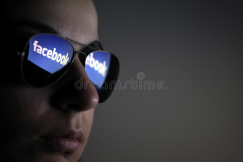 Facebook glasses. Bucharest, Romania - March 27, 2012: Facebook logo is reflected in a pair of glasses. Facebook is a social networking service launched in
