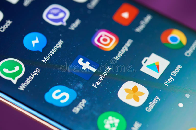 Facebook icon on mobile screen royalty free stock photo