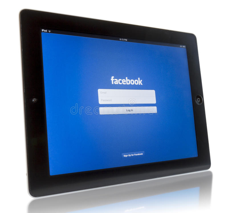 Facebook on iPad 3 stock photography