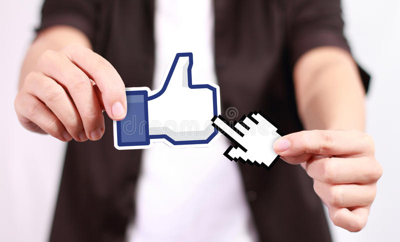 Facebook Like Button. Johor, Malaysia - July 21, 2013: This 'like' icon button is the voting system used to rate user comments on Facebook. Low Shu Ching hand