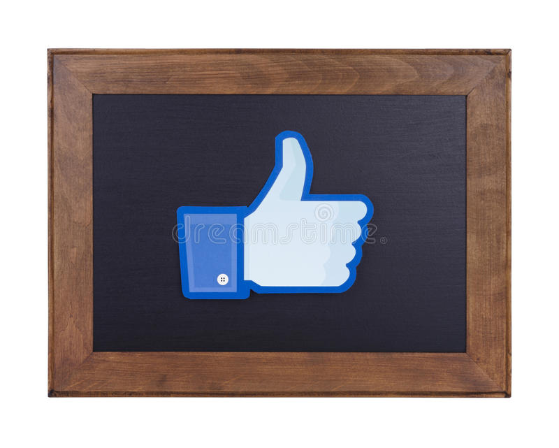 Facebook logo printed on paper and placed on a blackboard. Facebook social network stock images