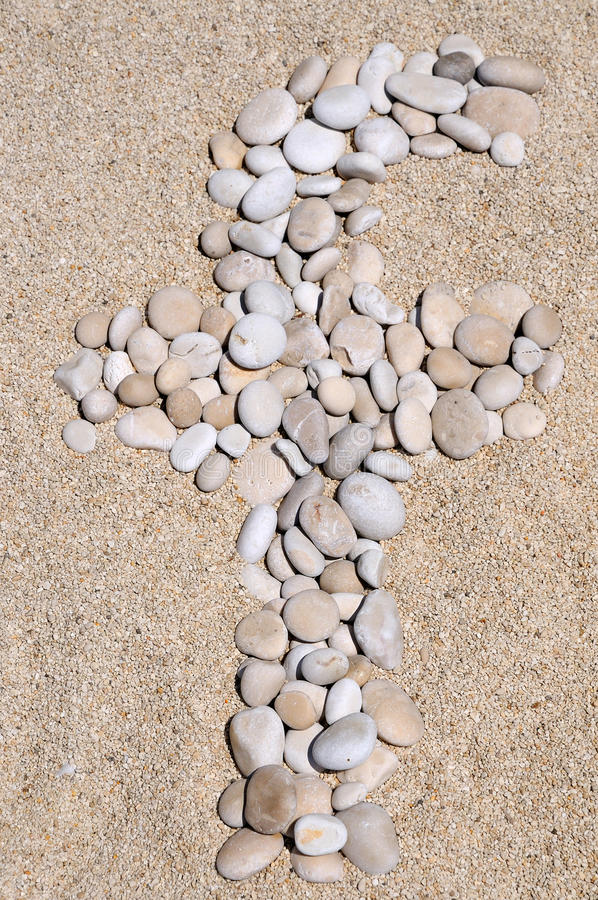 Facebook rocks. Facebook logo made from small rocks on sand background stock image