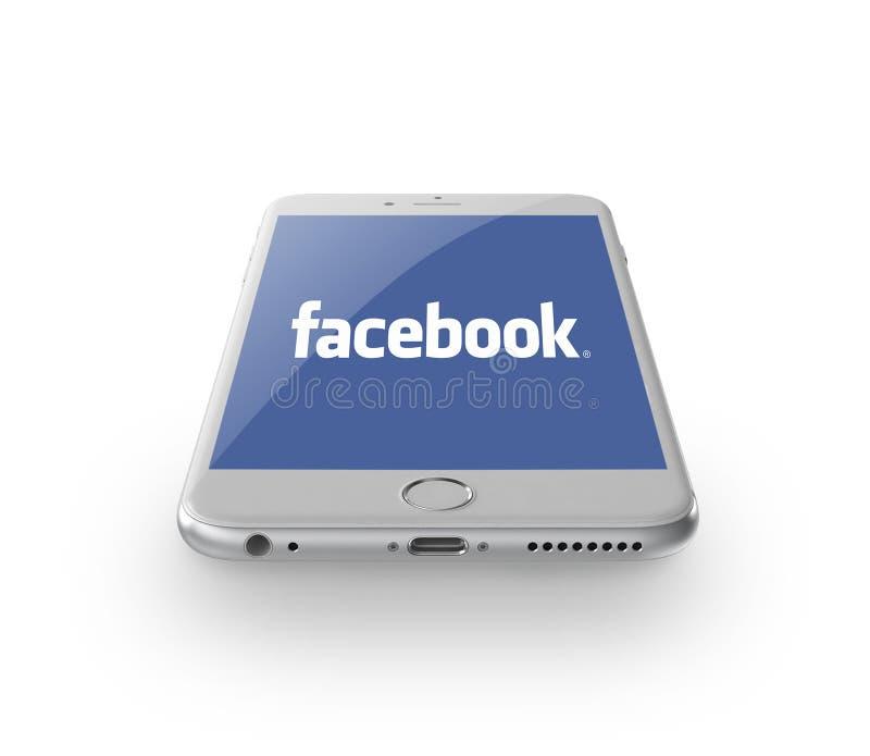 Facebook tecken på iphone royaltyfria foton