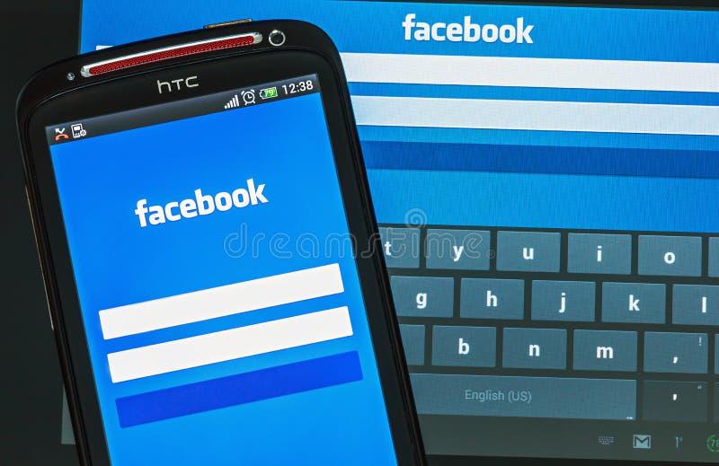 Facebook-Teken in pagina op mobiele telefoon royalty-vrije stock afbeelding