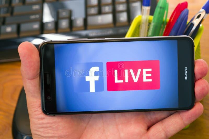 Facebook vivant au bureau photo libre de droits