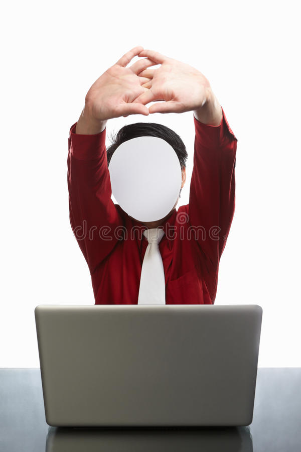 Faceless businessman and laptop. Series of faceless businessman with different gestures in front of his laptop, isolated on white royalty free stock photography