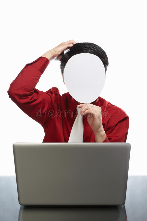 Faceless businessman and laptop. Series of faceless businessman with different gestures in front of his laptop, isolated on white royalty free stock images
