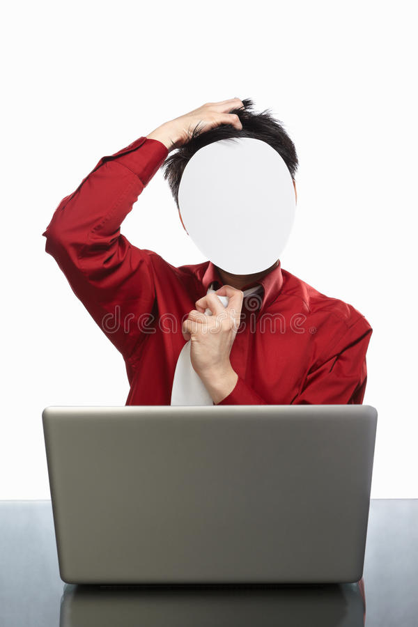 Faceless businessman and laptop. Series of faceless businessman with different gestures in front of his laptop, isolated on white royalty free stock photos