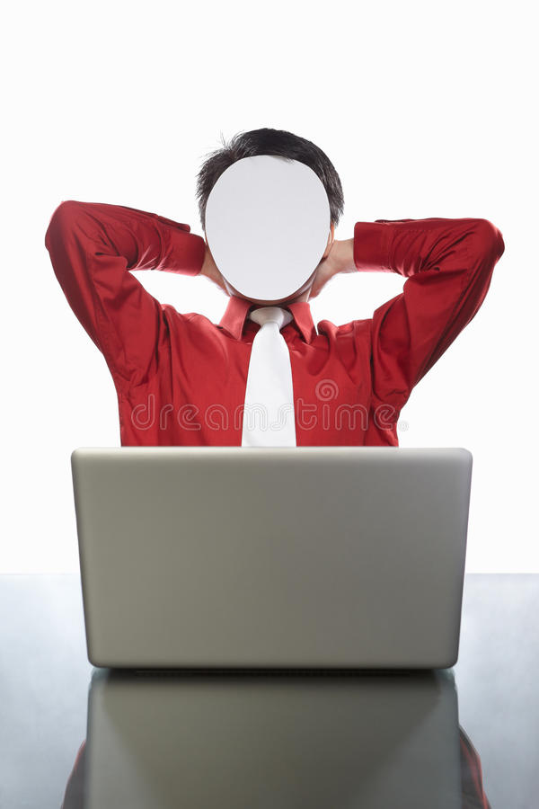 Faceless businessman and laptop. Series of faceless businessman with different gestures in front of his laptop, isolated on white stock photo