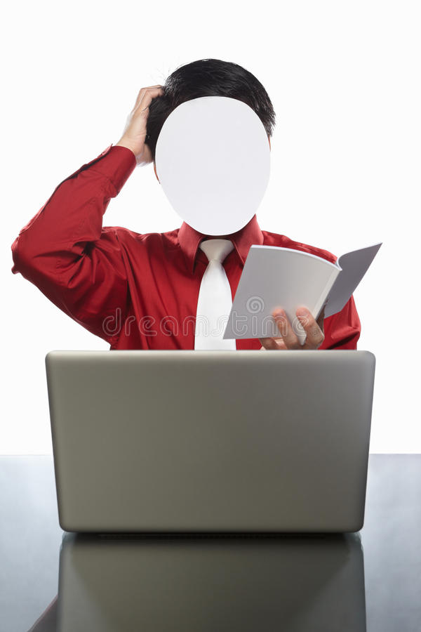 Faceless businessman and laptop. Series of faceless businessman with different gestures in front of his laptop, isolated on white royalty free stock image