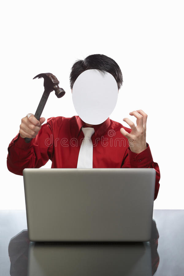 Faceless businessman and laptop. Series of faceless businessman with different gestures in front of his laptop, isolated on white stock image