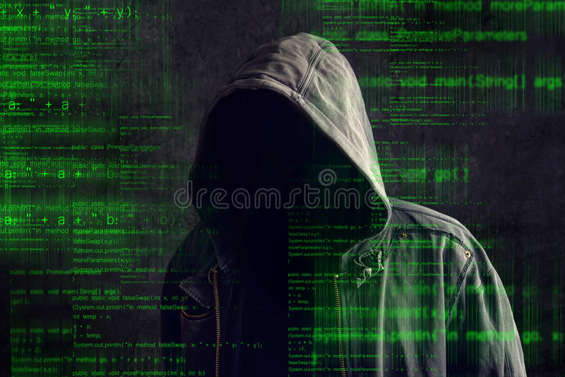 Faceless hooded anonymous computer hacker royalty free stock image