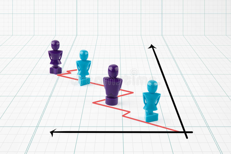 Faceless male and female figurines situated on line graph stock image