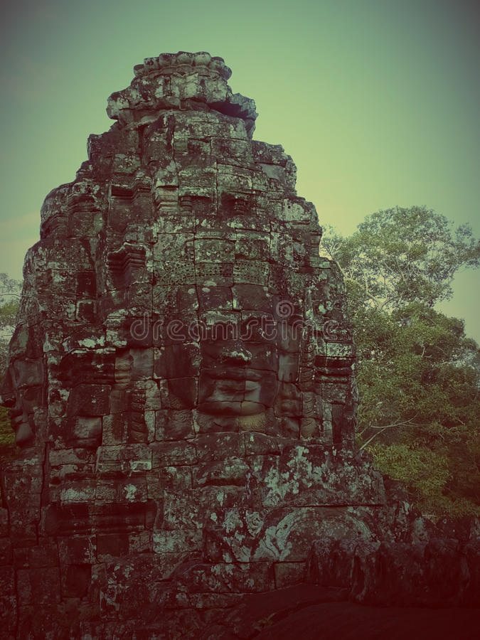 Faces of Bayon tample. Ankor wat. Cambodia. Faces of Bayon tample in the tree tops. Ankor wat. Cambodia royalty free stock photos