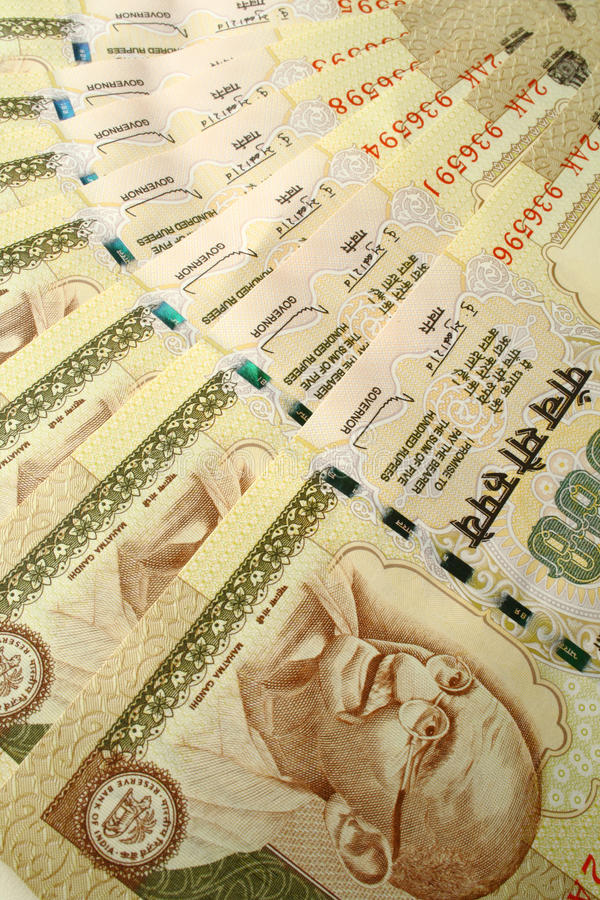 Faces de Gandhi na moeda imagem de stock royalty free