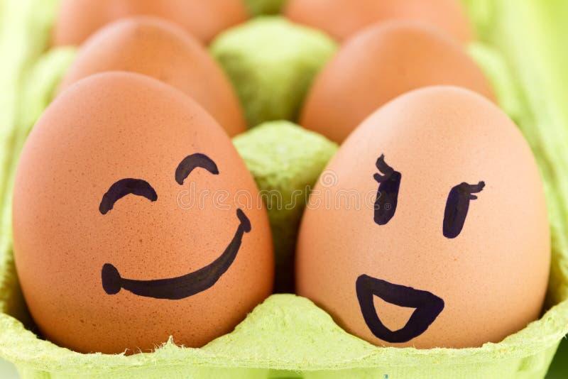 Faces do smiley em ovos imagens de stock royalty free