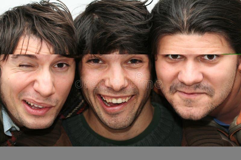 Faces engraçadas dos homens fotografia de stock