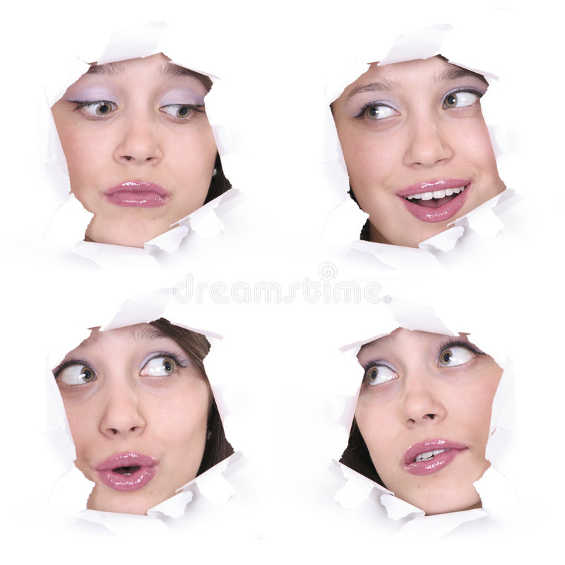 Faces of the girl in a paper hole royalty free stock photography