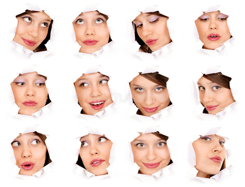 Faces of the girl in a paper hole stock photos