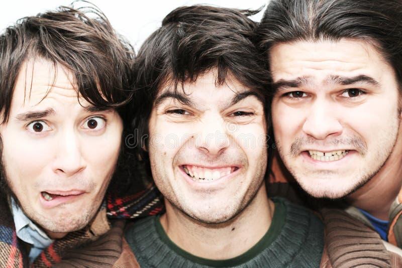 Faces loucas dos homens foto de stock royalty free