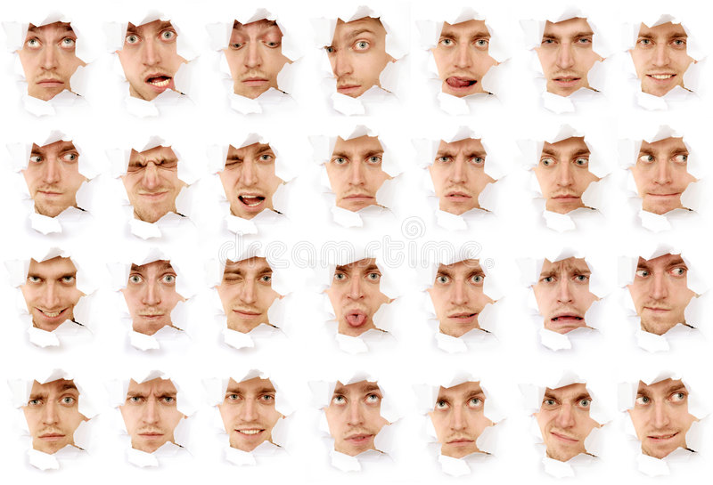 Faces of the man in a paper hole royalty free stock photos