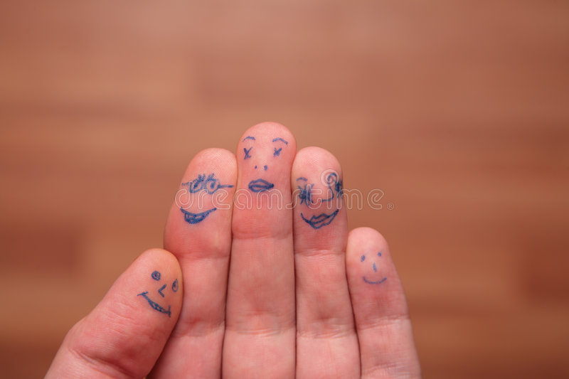 Faces painted on fingers stock photography