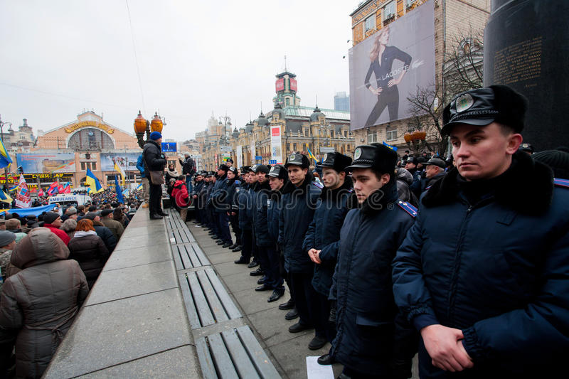 Download Faces Of The Police Forces Guarding The Last Monument Of The Communist Leader Lenin During The Pro-European Protest Editorial Stock Photo - Image: 35710008