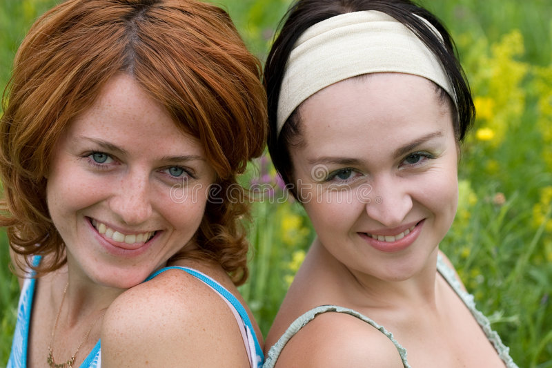 Faces of smiling girls stock photo