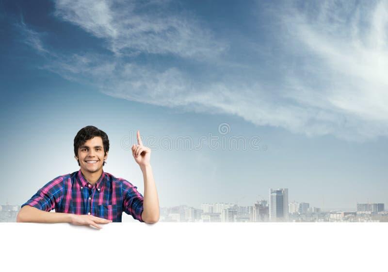 Facet w przypadkowym z plakatem obraz stock