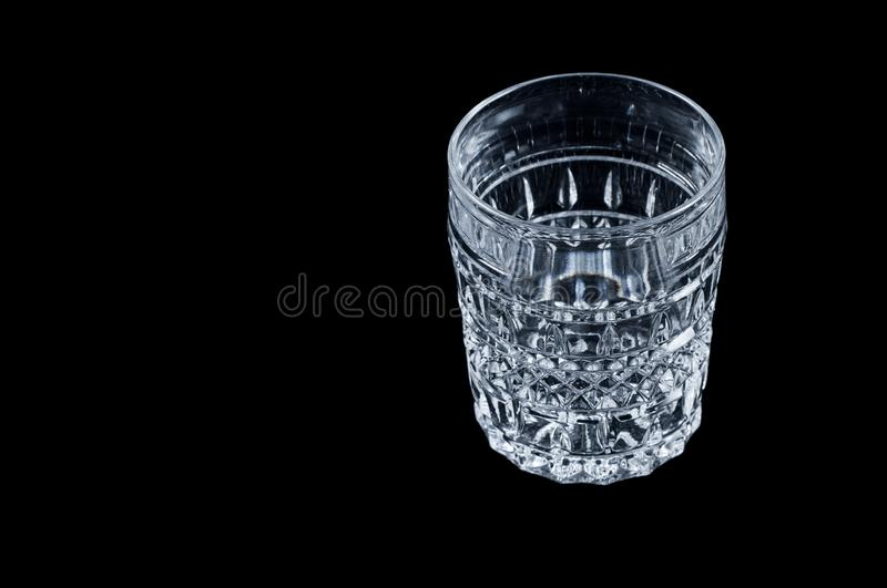 Faceted vintage glass on a black background, isolate. royalty free stock photography