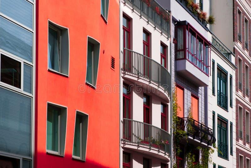 Fachadas de construção coloridas - conceito dos bens imobiliários fotografia de stock royalty free