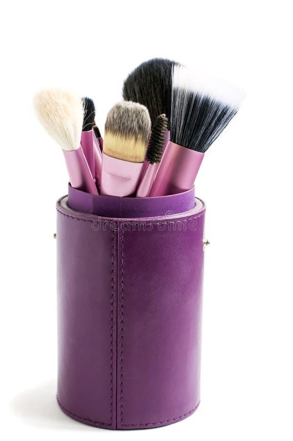 Fachowi muśnięcia dla makijażu w purpury tubce obrazy royalty free