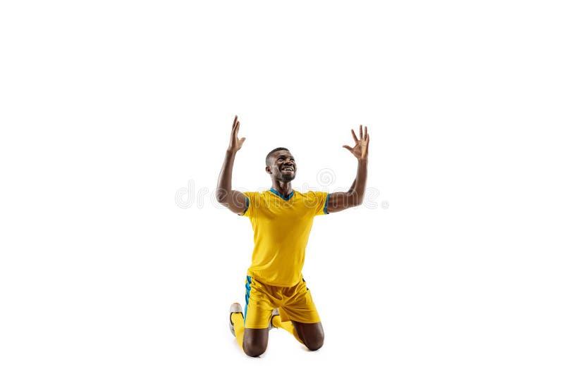 Fachowy afrykański futbolowy gracz piłki nożnej odizolowywający na białym tle obrazy royalty free