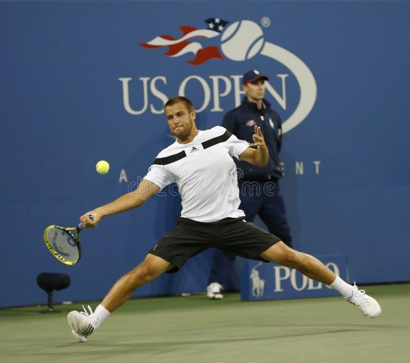 Fachowy gracz w tenisa Mikhail Youzhny podczas ćwierćfinału dopasowania przy us open 2013 przeciw Novak Djokovic zdjęcia stock