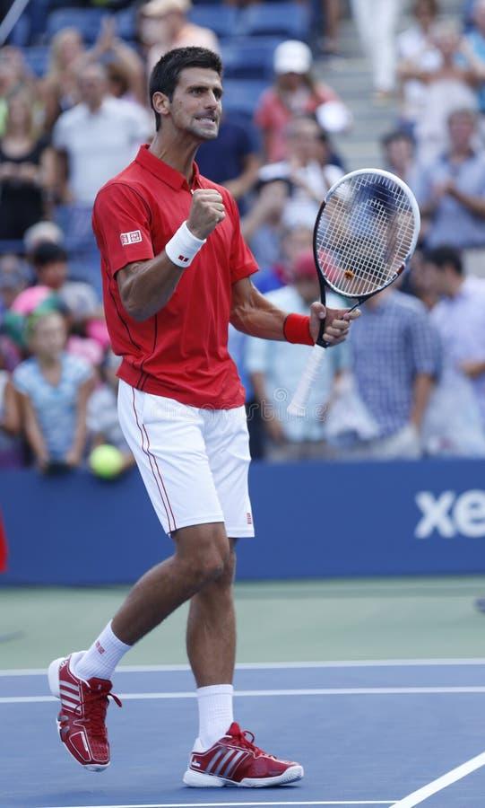 Fachowy gracz w tenisa Novak Djokovic świętuje zwycięstwo po round dopasowania fourth przy us open 2013 przeciw Marcel Granollers fotografia stock