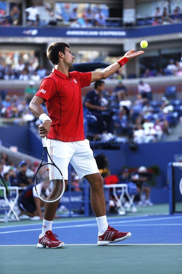 Fachowy gracz w tenisa Novak Djokovic podczas round dopasowania przy us open 2013 przeciw Marcel Granollers fourth obraz royalty free