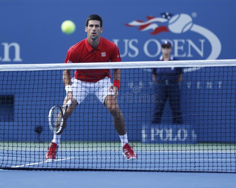 Fachowy gracz w tenisa Novak Djokovic podczas round dopasowania przy us open 2013 przeciw Marcel Granollers fourth obrazy royalty free