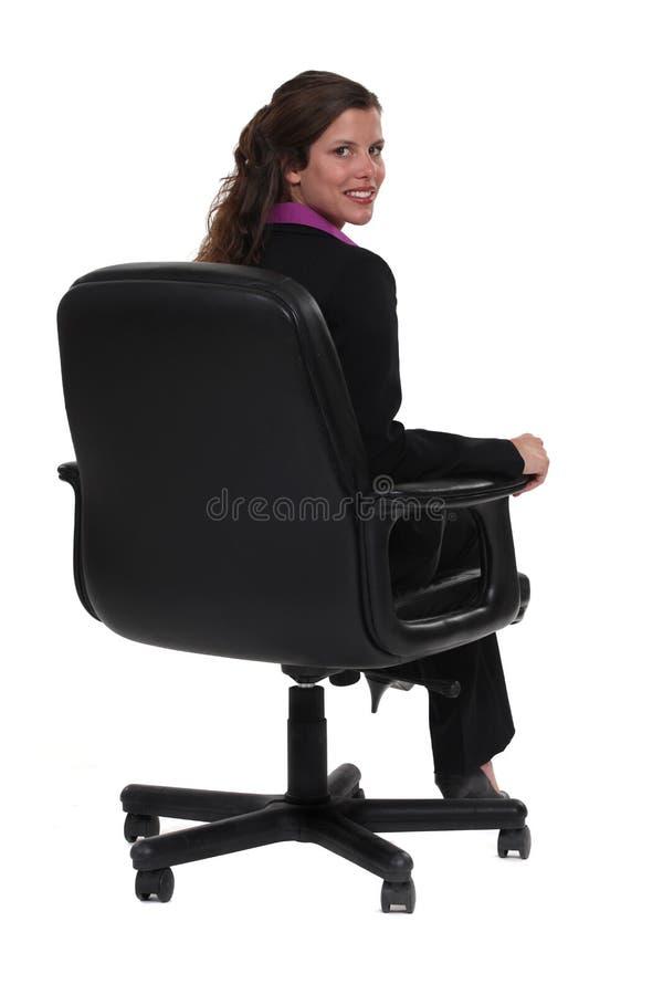 Fachowy obsiadanie w krześle zdjęcia stock
