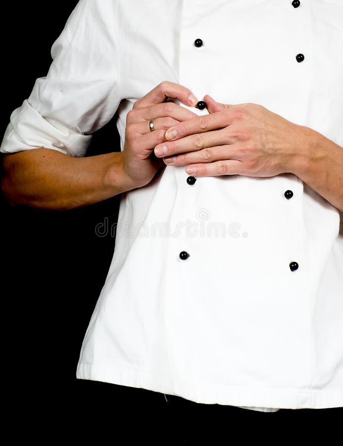 Fachowy szef kuchni zapina w górę białej szef kuchni kurtki zdjęcie royalty free