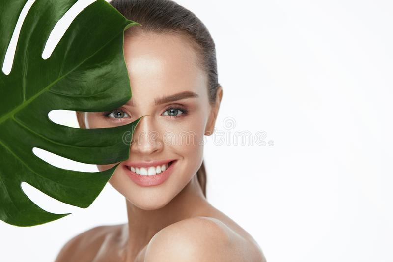 Facial Beauty. Beautiful Woman With Fresh Healthy Skin royalty free stock photo