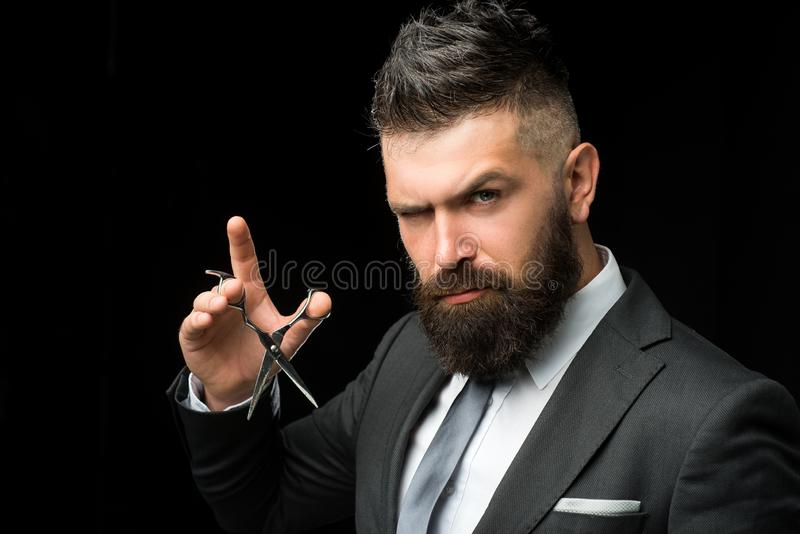 Facial care. bearded man in formal business suit. brutal male hipster cut hair with hairdressing scissors. confident royalty free stock images
