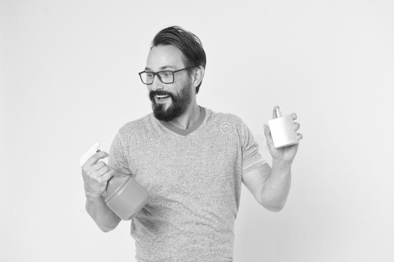 Facial care. Male fashion. Bearded man. Mature hipster with beard. brutal caucasian hipster with moustache. householding. Single man with spray bottle and royalty free stock photo