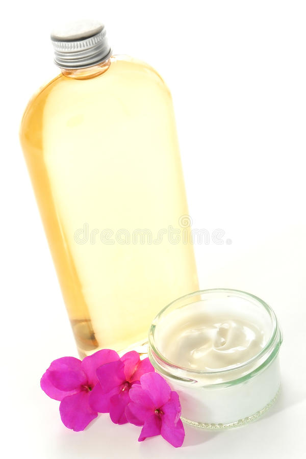 Facial Cream in Jar and Body Oil Bottle in a Spa royalty free stock images
