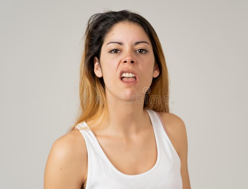 Human expressions and emotions. Desperate young attractive woman with angry face looking furious. Facial expressions, emotions Anger. Young attractive caucasian stock image