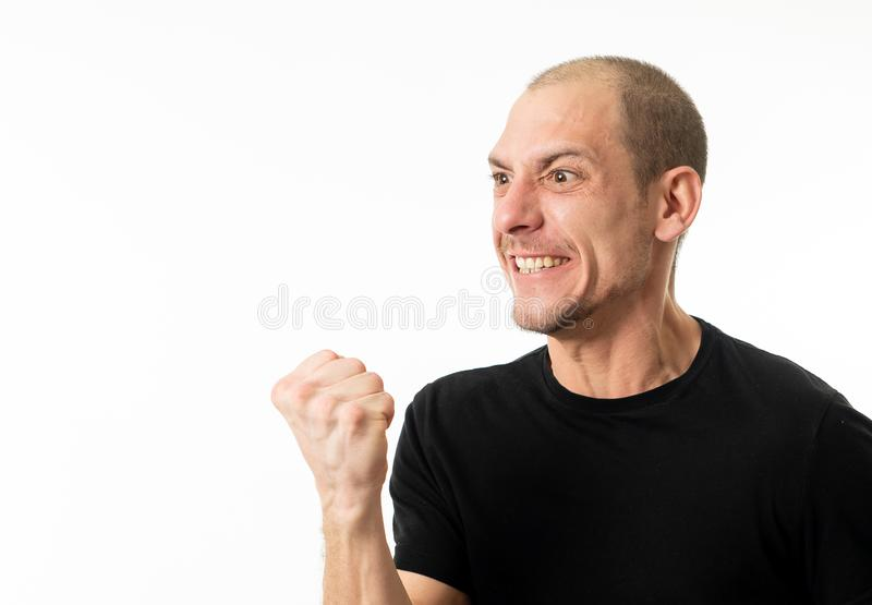 Facial expressions and emotions. Portrait of young man with crazy happy face celebrating victory stock image