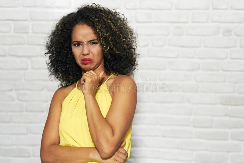 Facial Expressions Of Young Black Woman On Brick Wall royalty free stock photos