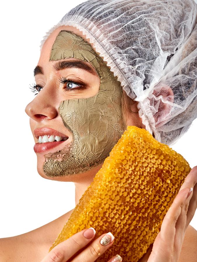 Facial honey clay face mask woman. Honeycombs homemade organic threatment. stock images
