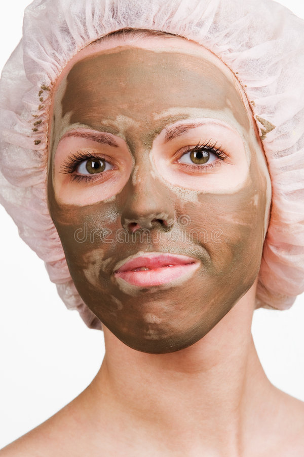 Facial mask. Young healthy woman with facial mask stock image
