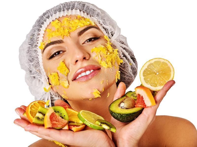 Facial mask from fruits for woman. Girl in medical hat. royalty free stock image